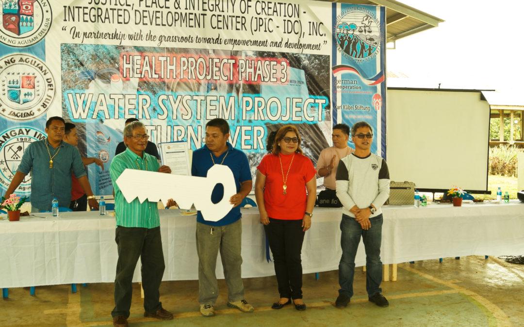 JPIC-IDC turns over water system to Barangay Imelda